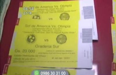 Detienen a hinchas de Olimpia por vender entradas falsas