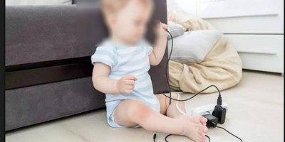 Bebé murió al morder  cable de un cargador