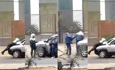 HOY / VIDEO| Cuando la agresión  la perpetra el automovilista:  golpea y casi arrolla a agente