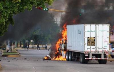 Feroces enfrentamientos en bastión del capo mexicano El Chapo por arresto de su hijo