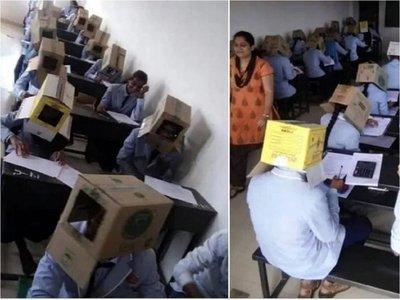 Piden a alumnos usar cajas de cartón en la cabeza para evitar copiarse