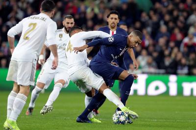 PSG rescata un punto del Bernabéu y gana su grupo