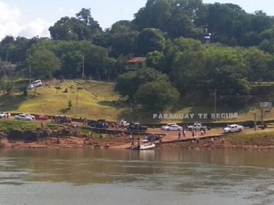 Flotó en el río un cuerpo con nueve impactos de bala