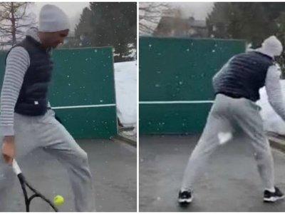 Federer se entrena bajo nieve los golpes especiales