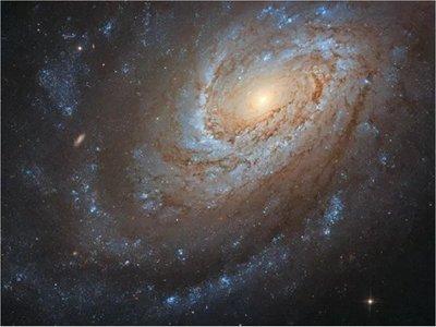 Registran foto de una galaxia caníbal