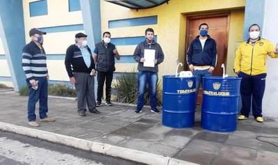Hinchas donan tambores sanitarios y exigen reapertura de la Secretaría • Luque Noticias