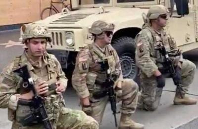 Protestas por muerte de George Floyd: Guardia Nacional se arrodilla ante manifestantes