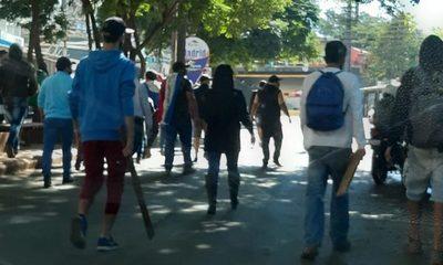 Violentos manifestantes exigen a comerciantes adherirse a movilización